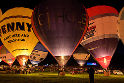 © Licensed to London News Pictures.  10/08/2017; Bristol, UK. Bristol International Balloon Fiesta 2017. The Nightglow. Balloons inflate for the crowds and use their gas burners to light up the balloon canopies, set to music. Picture credit : Simon Chapman/LNP