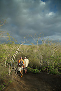 Tourists exploring Isabella Island. Galabagos, Ecuador, South America