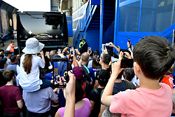 Chelsea fans try to get a view of Chelsea players arriving at the stadium before the Premier League match at Stamford Bridge, London.