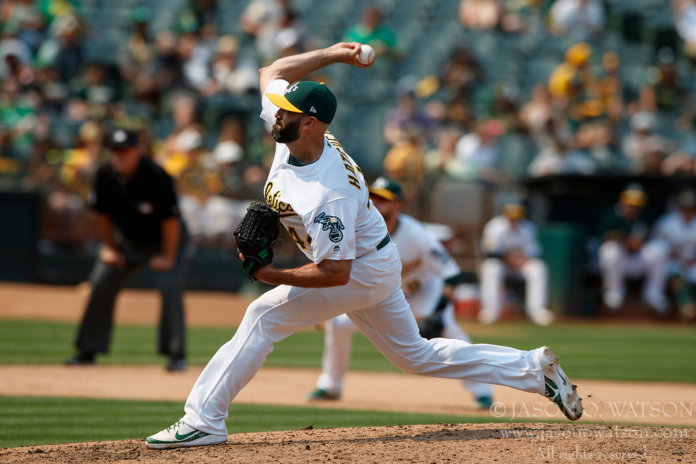OAKLAND, CA - JULY 01: Chris Hatcher #44 of the Oakland Athletics pitches against the Cleveland Indians during the eighth inning at the Oakland Coliseum on July 1, 2018 in Oakland, California. The Cleveland Indians defeated the Oakland Athletics 15-3. (Photo by Jason O. Watson/Getty Images) *** Local Caption *** Chris Hatcher