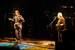 Bob Weir and Jerry Garcia. The Grateful Dead in Concert at the Brendan Bryne Arena, East Rutherford NJ, on March 30th 1988. View front of stage at level from stage left arena.