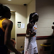 Sisters Chiney Ogwumike, (right), Connecticut Sun and Nneka Ogwumike, Los Angeles Sparks, head back to the dressing rooms after the Connecticut Sun Vs Los Angeles Sparks WNBA regular season game at Mohegan Sun Arena, Uncasville, Connecticut, USA. 3rd July 2014. Photo Tim Clayton