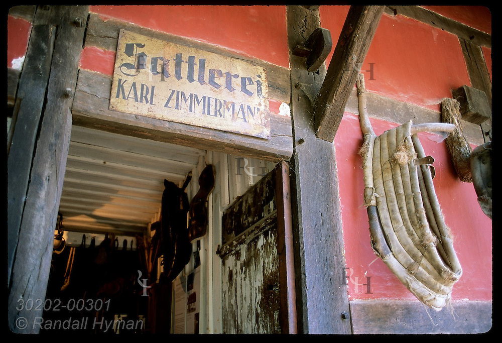 Zimmermann Saddlery sign hangs above original bldg at Ecomusee folk museum; Ungersheim, Alsace. France