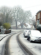 Snow falls in a a village outside Ashford, Kent during as Storm Darcy hits the UK