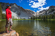 Hiker enjoying the view at Fern Lake, Ansel Adams Wilderness, June Lake, California