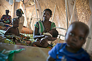Mothers tend children with malnutrition in the Malnutrition Tent operating under MSF(Médecins sans Frontières) -France in Carnot Hospital, Carnot, Central African Republic. According to MSF, the current military conflict exacerbated medical needs and caused humanitarian crisis, thus a large proportion of the population, especially in rural areas, does not have access to the most basic healthcare.