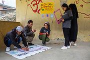 Volunteers from the Tikabhairav group preparing for a nutrition workshop with the community, Tikabhairav, Karyabinayak, Nepal. ICS / Restless Development volunteers in the Dakshinkali region of Nepal. (© Andy Aitchison / ICS)