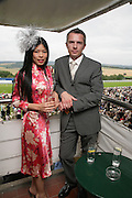 Vanessa Mae and Lionel Catelan, Glorious Goodwood. 2 August 2007.  -DO NOT ARCHIVE-© Copyright Photograph by Dafydd Jones. 248 Clapham Rd. London SW9 0PZ. Tel 0207 820 0771. www.dafjones.com.