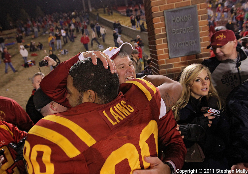 November 18, 2011: Iowa State Cyclones head coach Paul Rhoads greets Iowa State Cyclones defensive end Cleyon Laing (90) after the end of the NCAA football game between the Oklahoma State Cowboys and the Iowa State Cyclones at Jack Trice Stadium in Ames, Iowa on Friday, November 18, 2011. Iowa State upset Oklahoma State 37-31 double overtime.