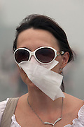 Moscow, Russia, 07/08/2010. .A woman in Red Square wears a  protective mask in the worst smog so far in the record high temperatures of the continuing heatwave. Peat and forest fires in the countryside surrounding Moscow have resulted in the Russian capital being blanketed in heavy smog.