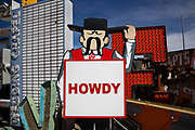 "Howdy sign in the Neon Boneyard which features more than 150 signs. For many years, the Young Electric Sign Company stored many of these old signs in their ""boneyard."" The signs were slowly being destroyed by exposure to the elements. Private donations and loans have expanded the collection to the current size."