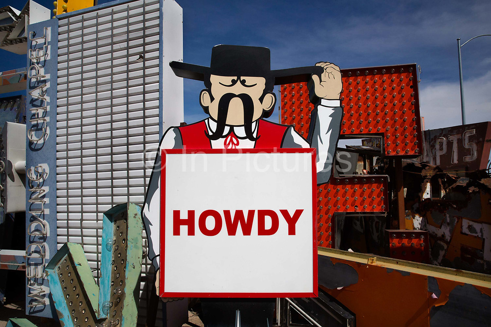 """Howdy sign in the Neon Boneyard which features more than 150 signs. For many years, the Young Electric Sign Company stored many of these old signs in their """"boneyard."""" The signs were slowly being destroyed by exposure to the elements. Private donations and loans have expanded the collection to the current size."""