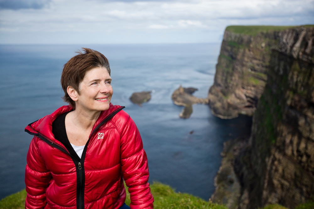 """Mykines Island, Faroe Islands.  <br /> <br /> Mykines Island, Faroe Islands.  Olga Biskopsto is a coordinator for the Faroe islands special interest association called """"Útoyggjafelagid.""""   Olga is responsible for economic growth of the eight smallest islands in the Faroes.  Through meetings with local politicians,  she strategizes in the creation of new jobs and projects for the local people and creates incentive ideas for the locals to remain on their islands-rather than leaving to other countries."""