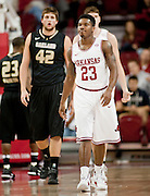 Nov 16, 2011; Fayetteville, AR, USA;  Arkansas Razorback guard Julysses Nobles (23) and Oakland Grizzlies forward Corey Petros (42) walk down the court following a play during a game at Bud Walton Arena. Arkansas defeated Oakland 91-68. Mandatory Credit: Beth Hall-US PRESSWIRE