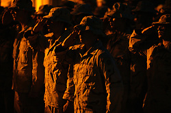Soldiers from the 2nd Battalion 325th Airborne Infantry Regiment 82nd Airborne Division mourn the loss of Staff Sgt. Brian Hellerman and Pvt. Kyle Gilbert, Baghdad, Iraq, on Aug. 10, 2003.The two soldiers were killed in an attack by Iraqi resistance Aug. 6, 2003.