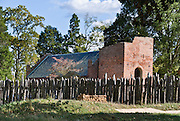 A palisade of the James Fort defends the Memorial Church. Jamestown Church, partially built in 1639 in Jamestown, Virginia, is one of the oldest surviving buildings built by Europeans in the original thirteen colonies that became the United States of America. The current church tower was built 1639-1644. The rest of the original church was destroyed after abandonment in 1750 when a new church was built 3 miles away. In 1906, the National Society of the Colonial Dames of America built the present church on the cobblestone foundations of the older 1617 church and brick foundations of the 1639 church, now visible through glass flooring. Dedicated in 1917, Historic Jamestowne Memorial Church is now part of Jamestown National Historic Site, and is owned by the Association for the Preservation of Virginia Antiquities.