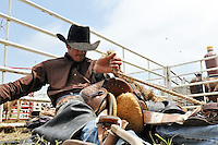 Lucas Wilson, 26, from Queensland, Australia gets his saddle perfect before his big shot on Saturday at the 2013 California Rodeo Salinas.