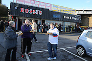 fans eat their pre match fish and chips outside the Liberty Stadium. Premier league match, Swansea city v West Ham United at the Liberty Stadium in Swansea, South Wales on Boxing Day, Monday 26th December 2016.<br /> pic by  Andrew Orchard, Andrew Orchard sports photography.