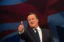 © Licensed to London News Pictures . 07/10/2015 . Manchester , UK . Prime Minister DAVID CAMERON gives a thumbs up to Boris Johnson as he delivers the leader's speech . The Conservative Party Conference at the Manchester Central Convention Centre . Photo credit : Joel Goodman/LNP