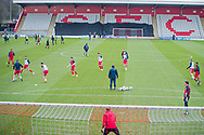 General view of the Lamex as Stevenage players warm up before the EFL Sky Bet League 2 match between Stevenage and Morecambe at the Lamex Stadium, Stevenage, England on 6 February 2021.