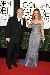 Oct. 10, 2017 -  (File Photo) - Movie producer Harvey Weinstein is being accused of sexual harassment allegations, which has led to him being fired. PICTURED: January 8, 2017 - Los Angeles, California, United States - Executive HARVEY WEINSTEIN, and Actress GEORGINA CHAPMAN  at the  74th Golden Globe Awards arrivals held at the Beverly Hilton Hotel. (Credit Image: © Paul Fenton via ZUMA Wire)