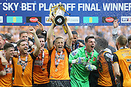 Michael Dawson of Hull City lifts the Sky Bet Championship Playoff Trophy with his team mates .Skybet football league Championship play off final match, Hull city v Sheffield Wednesday at Wembley Stadium in London on Saturday 28th May 2016.<br /> pic by John Patrick Fletcher, Andrew Orchard sports photography.