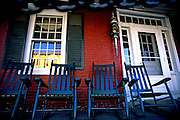 Image of rocking chairs on a porch in downtown Stowe, Vermont, American Northeast by Andrea Wells