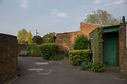 Last light at Cressingham Gardens estate on 11th May 2017 in South London, United Kingdom. Cressingham Gardens is a council garden estate in Lambeth. Located on the southern edge of Brockwell Park, it comprises of 306 dwellings. It was designed at the end of the 1960s by the Lambeth Borough Council architect Edward Hollamby, and built at the start of the 1970s. In 2012 Lambeth Council proposed regeneration of the whole estate, a decision highly opposed by many residents and a campaign to stop the redevelopment has been in place since.