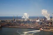 Nederland, Noord-Holland, Velsen, 16-04-2008; zicht op het terrein van Corus (voorheen Hoogovens), met links een van de cokesfabrieken, rechts de eigenlijke hoogovens; in de voorgrond het Noordzee Kanaal waarop afvalwater op geloosd wordt; de sluier over de foto is het gevolg van (plaatselijke) smog..luchtfoto (toeslag); aerial photo (additional fee required); .foto Siebe Swart / photo Siebe Swart