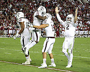 TUSCALOOSA, AL - NOVEMBER 10:  Quarterback Johnny Manziel #2 of the Texas A&M Aggies (right) celebrates with other teammates during the game against the Alabama Crimson Tide at Bryant-Denny Stadium on November 10, 2012 in Tuscaloosa, Alabama.  (Photo by Mike Zarrilli/Getty Images)
