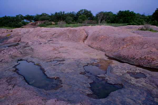 Stock photo of the pink granite boulders along the Llano River in the Texas Hill Country
