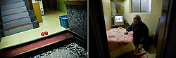 LEFT:  A pair of slippers are seen at a cheap motel where many day labors live in Kamagasaki, Japan. <br /> <br /> RIGHT: Hiromi Okamoto, 74, lives in a tiny room paid by welfare in Kamagasaki, Japan.