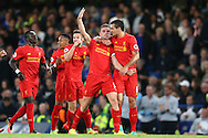GOAL / CELE - Jordan Henderson of Liverpool (2nd right)  celebrates towards the Liverpool fans after scoring his sides 2nd goal to make it 0-2 with Dejan Lovren of Liverpool. Premier league match, Chelsea v Liverpool at Stamford Bridge in London on Friday 16th September 2016.<br /> pic by John Patrick Fletcher, Andrew Orchard sports photography.