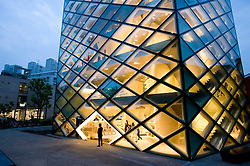 Evening view of beautiful glass walled Prada store in Tokyo 2008 Futuristic Prada fashion boutique in Tokyo