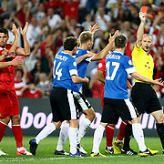 Referee's Marcin Borski show the red card to Enar JAAGER (N17) during their FIFA World Cup 2014 qualifying soccer match Turkey betwen Estonia at Sukru Saracoglu stadium in Istanbul September 11, 2012. Photo by TURKPIX