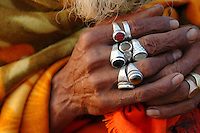 """India, Nasik, 2006. Morning's soft light reflects off the rings of a """"sadhu'"""" or traveling holy man, on the banks of the Godavari River. Winner of National Geographic Traveler's First Prize."""
