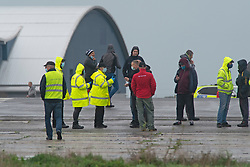 © Licensed to London News Pictures 23/12/2020.        Manston, UK. Medical staff at the airport. The Army and NHS staff have arrived at Manston Airport to administer Covid-19 lateral flow tests to truckers who are stranded in Kent. Angry lorry drivers blockading local roads and clashed with police in Kent this morning. France have closed its borders to all freight traffic because of the new Coronavirus strain. Photo credit:Grant Falvey/LNP
