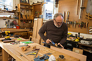 A mature man in his workshop.