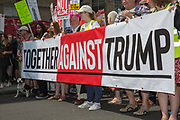Activists protest against US President Donald Trumps UK visit on the 13th July 2018 in central London in the United Kingdom. Donald Trump is on a UK visit, meeting with Prime Minister Theresa May to discuss topics such as Brexit, negotiating a trade deal, and immigration. Trump will also visit the Queen, Blenheim Palace and Scotland. Widespread protests have been organised across the United Kingdom during Mr. Trumps visit, including a Trump Baby blimp to float over the anti-Trump march. Much of the protests have been organised by left wing journalist Owen Jones.