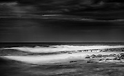 Surf breaking on rocky shoreline at Shellharbour, NSW, Australia,