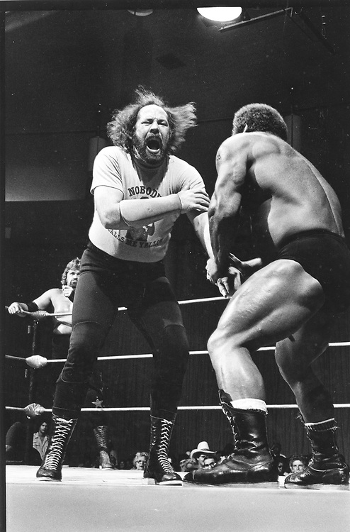 ©1986 Championship wrestling in Austin, TX   Ivan Putsky on the right.