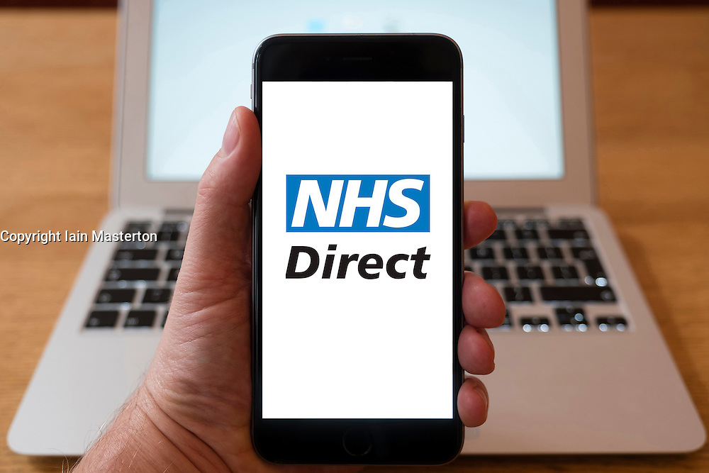 Using iPhone smartphone to display logo of NHS Direct , National Health Service website