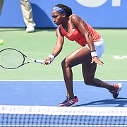 COCO GAUFF hits a forehand volley at the Rock Creek Tennis Center.