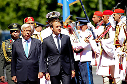 September 7, 2017 - Athens, Greece - Greek President Prokopis Pavlopoulos, left, and his French counterpart Emmanuel Macron, review the Presidential Guard in Athens. Macron arrived in Greece Thursday for a two-day visit during which he was expected to outline his vision for the future of the European Union and discuss Greece's financial crisis (Credit Image: © Aristidis Vafeiadakis via ZUMA Wire)