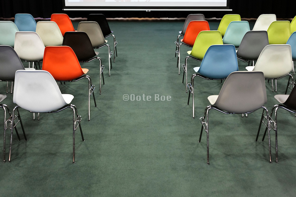 rows of empty chairs at a conference centre