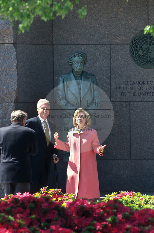President Bill Clinton and First Lady Hillary walk past a statue of Eleanor during a walk through of the FDR Memorial May 2, 1997 in Washington, DC. Accompanying the Clintons are the designer of the memorial Lawrence Halprin.