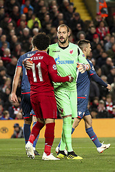 October 24, 2018 - Liverpool, England, United Kingdom - Crvena Zvezda goalkeeper Milan Borjan (82) hugs Liverpool forward Mohamed Salah (11) during the Uefa Champions League Group Stage football match n.3 LIVERPOOL - CRVENA ZVEZDA on 24/10/2018 at the Anfield Road in Liverpool, England. (Credit Image: © Matteo Bottanelli/NurPhoto via ZUMA Press)