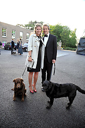 BEN & MARINA FOGLE with their dogs Maggie and Inca at the annual Dog's Trust Honours Awards held at The Hurlingham Club, Fulham, London on 19th May 2009.