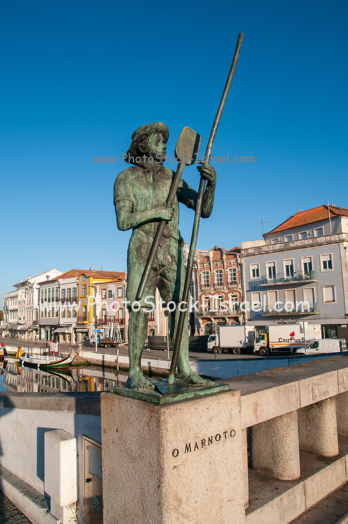 Bronze statue of a male salt worker (O Marnoto) overlooking the canal, Aveiro, Portugal