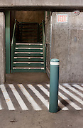 Stairs leading out of the concrete lower level of a parking garage. Missoula Photographer